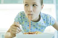 Girl slurping spaghetti noodles