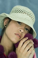 Teen girl wearing sun hat, close-up, portrait