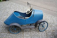 Old blue metal car for kids, Amsterdam, Holland, Netherlands