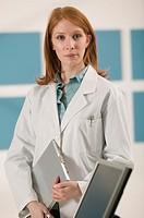 Medical professional holding tablet pc, portrait