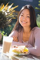 Woman having lunch at outdoor restaurant