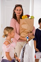 Woman with children and groceries