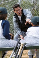 Coach talking to boys on little league team