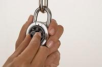 Woman unlocking padlock
