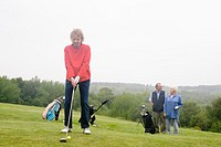 Senior woman playing golf