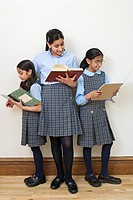 Schoolgirls reading