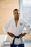 Man wearing gi with hands on hips
