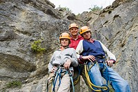 Portrait of family rock climbing
