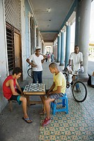 Young people playing chess in a centric street (P. del Prado). Cienfuegos. Cuba