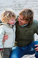 Mid adult man with his son on the beach