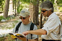 CALIFORNIA   South Lake Tahoe   Two middle aged men consult trail guide on Rubicon Trail