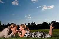 Young couple lying in a park and being romantic, Central Park, Manhattan, New York City, New York, USA