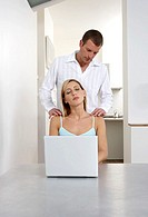 Young woman receiving a shoulder massage whilst working from home