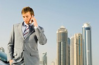 A businessman talking on a mobile phone (thumbnail)