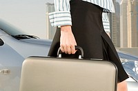 A businesswoman carrying a briefcase
