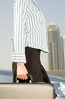 A businesswoman carrying a briefcase (thumbnail)