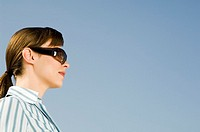 A businesswoman wearing sunglasses