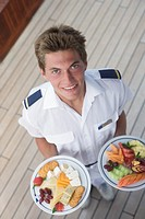 Waiter holding plates of food
