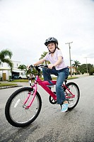 A young girl on a bike