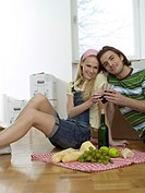 Couple having break in new flat