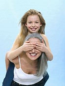 Girl sitting on woman's back, hiding her eyes (thumbnail)