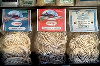 Close-up of stringozzi pasta in packets, Montefalco, Umbria, Italy