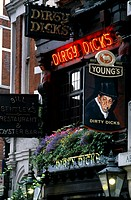 Neon signs at the entrance of a bar, Dirty Dick´s, Bishopsgate, London, England
