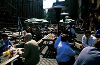 Group of people sitting at a sidewalk cafe, St  Marie Overy Dock, London, England