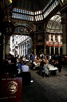 Large group of people sitting in a sidewalk cafe, Leadenhall Market, London, England
