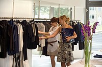 Women looking at clothes on display at a boutique