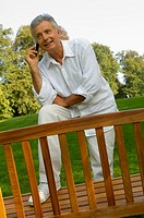 A senior man talking on his cell phone