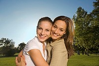 Two teenage girls hugging