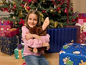 Girl holding a soft toy