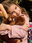 Girl holding a soft toy (thumbnail)