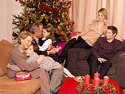 A family sitting together during Christmas