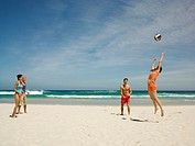 Friends playing volleyball on the beach