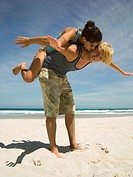 Man carrying girlfriend on back (thumbnail)