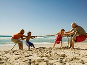 Children and grandparents playing tug of war