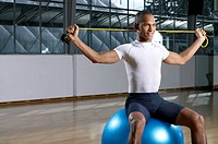 Man sitting on a fitness ball (thumbnail)