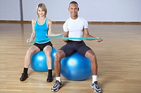 People sitting on a fitness ball