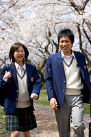 Two High School Students on Path with Cherry Blossoms in the Background