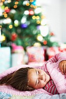 Girl Sleeping by Christmas Tree