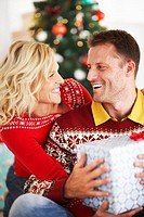 Woman Giving Man Christmas Gift
