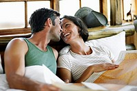 Couple on Vacation Relaxing in Bed