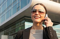 Businesswoman talking on a mobile phone and smiling (thumbnail)