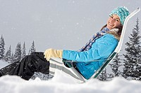 Well Bundled Woman Sitting Outdoors