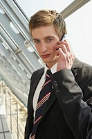 Businessman listening to a mobile phone
