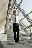 Businessman standing in a prayer position