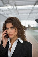 A businesswoman talking on her cell phone