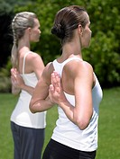 Two young women practicing yoga